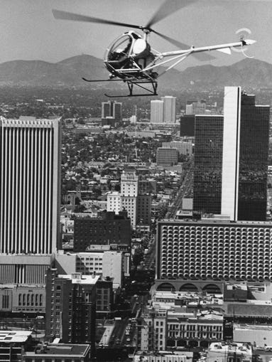 The first Phoenix police helicopter was a  Hughes  300C model which came onto the scene in 1974 when the aviation division was established with a single helicopter. Shortly after that a fixed wing aircraft and two more helicopters were added.  This photo was shot on April 30th, 1976 . The two seater had space for a single portable police radio,  a siren/PA which was removed from a patrol car and a searchlight.