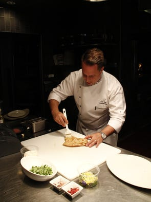 Chef Eric Vasta prepares a salad flatbread at JW Marriott