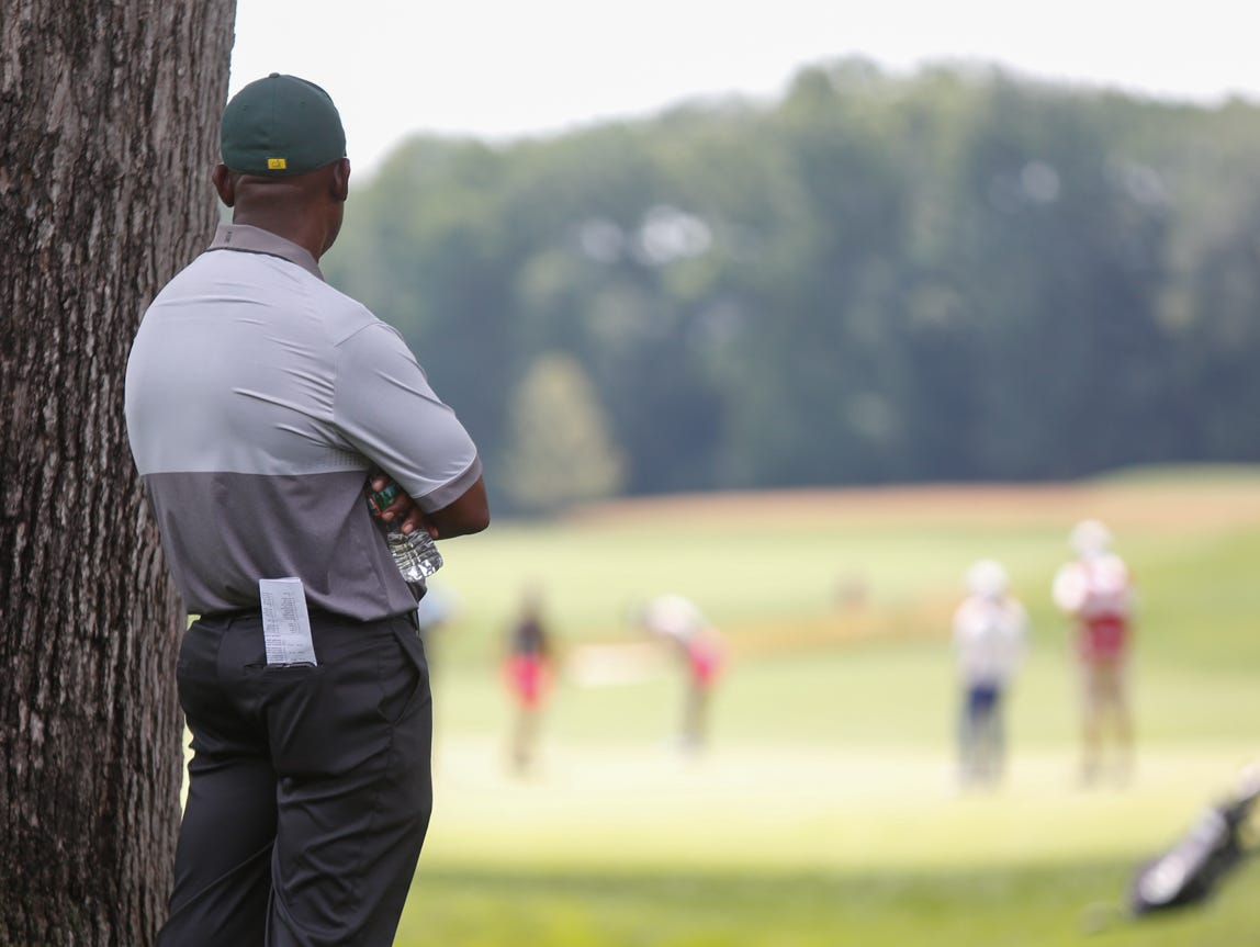 Keith Cox from South Salem watches from a distance as his daughter Kyra competes in the 68th USGA Girls Junior Amateur Championship at the Ridgewood Country Club in Paramus on Monday, July 18, 2016.