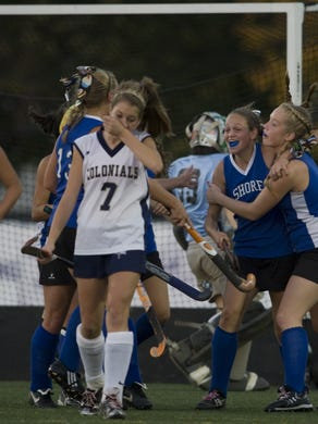 Shore Regional's Carol Middough (second from right) celebrates with teammate Erin Giles after scoring her teams first goal. Shore's #18 Hannah Barreca (on left) scored the game winner later on.   Shore Regional vs Freehold Boro in Shore Conference Field Hockey Final.
