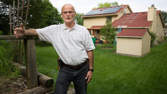 Bob Bernard is getting nine solar panels mounted to his house in Urbandale on Wednesday to go with the 15 panels previously installed by Green Light Renewable Services.