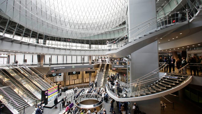 People gather for a ceremony at the entrance of the Fulton Center transit hub, Sunday, Nov. 9, 2014 in New York. The $1.4 billion hub links the World Trade Center to nine subway lines in lower Manhattan and is designed to serve up to 300,000 passengers daily. The center also features retail and office space.