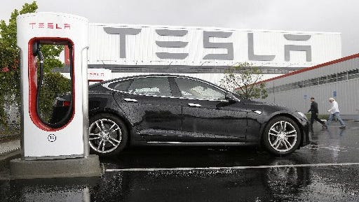 Tesla vehicle is parked at a charging station outside of the Tesla factory in Fremont, Calif., on Aug. 5, 2015.