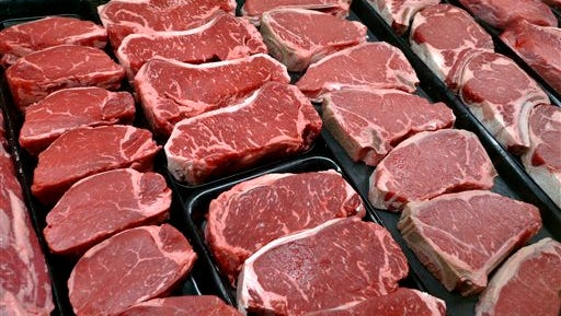 In this Jan. 18, 2010 file photo, steaks and other beef products are displayed for sale at a grocery store in McLean, Va. Americans may not have to cut back on eggs and salt as much as they once thought. And eating lean meat is still OK. But watch the added sugars _ especially the sugary drinks. The Obama administration's new dietary guidelines, released Jan. 7, 2016, back off the strictest sodium rules included in the last version, while still complaining that Americans consume too much salt.