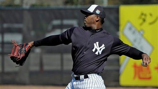 New York Yankees pitcher Aroldis Chapman throws during a spring training baseball workout Friday, Feb. 19, 2016, in Tampa, Fla. (AP Photo/Chris O'Meara)
