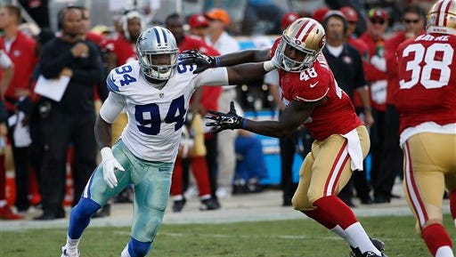 Dallas Cowboys defensive end Randy Gregory (94) is blocked by San Francisco 49ers tight end Rory Anderson (48) during the second half of an NFL preseason football game last year.