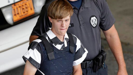 FILE - In this June 18, 2015 file photo, Charleston, S.C., shooting suspect Dylann Storm Roof is escorted from the Cleveland County Courthouse in Shelby, N.C. When nine black churchgoers in Charleston were massacred by Roof, a white man with Confederate sympathies, the city stayed calm and the victims' families offered examples of grace and forgiveness. Now that church shooting suspect Roof has been convicted in a federal death penalty trial, some say the parade of killings of black people feels at odds with the call to forgive.