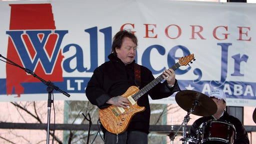 FILE - In this Feb. 18, 2006 file photo, Rick Derringer performs during a campaign rally kicking off George Wallace Jr's bid for the office of lieutenant governor in Montgomery, Ala.   Derringer has pleaded guilty, Friday, Feb. 24, 2017, and agreed to pay a $1,000 fine after stepping off a Delta Air Lines flight from Mexico with a loaded handgun in Atlanta's airport.
