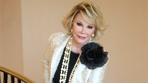 """Joan Rivers posing as she presents """"Comedy Roast with Joan Rivers """" during the 25th MIPCOM (International Film and Programme Market for TV, Video, Cable and Satellite) in Cannes, southeastern France. Rivers, who died Sept. 4 at age 81, is the opening act for """"Eating Delancey: A Celebration of Jewish Food."""" Set to be published in December by powerHouse Books, """"Eating Delancey"""" is a tribute to knishes, bagels, pickles and other staples of the Jewish immigrant community of Manhattan's Lower East Side. She provides some family stories and some Jewish jokes in the introduction."""
