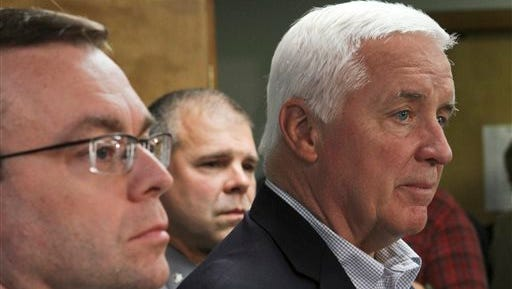 Pennsylvania Gov. Tom Corbett speaks of accused cop killer Eric Matthew Frein during a news conference at Blooming Grove Municipal Township Building in Blooming Grove Township, Pa., Monday. At left is Pike County District Attorney Ray Tonkin and in center is Pennsylvania State Police Lt. Col. George Bivens.