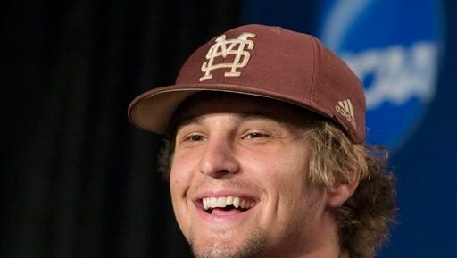 Mississippi State's Kendall Graveman smiles during a news conference at TD Ameritrade Park in Omaha, Neb., Sunday, June 23, 2013, ahead of the NCAA College World Series best-of-three baseball finals. Mississippi State and UCLA will play in Game 1 of the finals on Monday. (AP Photo/Nati Harnik)
