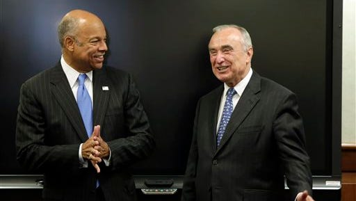 New York City Police Commissioner William Bratton, right, and Homeland Security Secretary Jeh Johnson chat before a security conference begins, in New York,  Monday, Sept. 15, 2014. Govs. Cuomo, Christie and Mayor de Blasio met with Secretary Johnson and a bi-state group of officials from local, state and federal law enforcement and public safety offices to discuss security preparedness and coordination in the New York-New Jersey region. (AP Photo/Richard Drew, Pool)