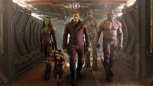 "This image released by Disney - Marvel shows, from left, Zoe Saldana, the character Rocket Racoon, voiced by Bradley Cooper, Chris Pratt, the character Groot, voiced by Vin Diesel and Dave Bautista in a scene from ""Guardians of the Galaxy."" The movie releases on Friday, Aug. 1, 2014. (AP Photo/Disney - Marvel)"