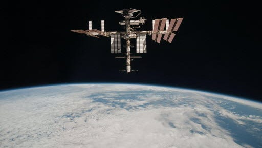 The International Space Station at an altitude of approximately 220 miles above the Earth.