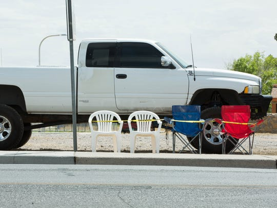 Las Cruces residents set up chairs along South Solano