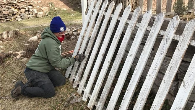 A Lincoln County EcoServants volunteer works on one of the many maintenance projects thr group takes on at the historic sites.
