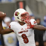 UofL QB Lamar Jackson passes during the University of Kentucky football game against University of Louisville at Commonwealth Stadium in Lexington, Ky., on Saturday, November 28, 2015. Photo by Mike Weaver