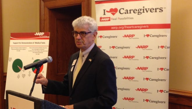 AARP State Director Kent Sovern speaks to reporters Monday, March 14.