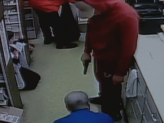 Image from surveillance video at Village Pharmacy in