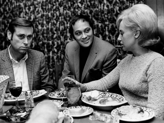 Country music singers George Jones, left, and Tammy Wynette, right, talk with Mario Ferrari while dining at Mario's, Ferrari's restaurant. The husband-wife singing team is one of the most popular personal appearance acts headquartered in Nashville.