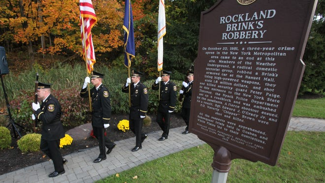 The Clarkstown Police Honor Guard presents the colors during the 31st annual Brinks robbery memorial ceremony in Nyack Oct. 20, 2012. ( Peter Carr / The Journal News )
