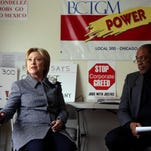 Democratic presidential candidate Hillary Clinton meets March 14, 2016, with Jethro Head, right, International Vice President of the Bakery, Confectionery, Tobacco Workers and Grain Millers International Union, who represents workers at the Chicago Nabisco factory.