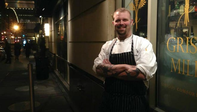 Executive chef Chris Willis stands on the street outside of Grist Mill Restaurant in Washington D.C.