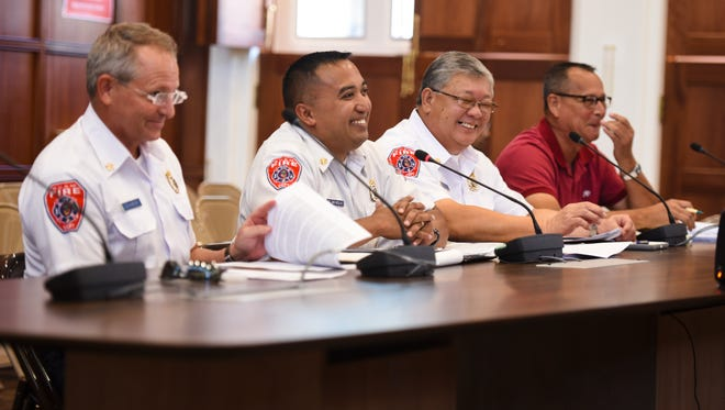 In this May 31 file photo, Fire Chief Joey San Nicolas, second from left, makes a lighthearted remark as he testifies before lawmakers on the 2018 fiscal year budget for his agency.