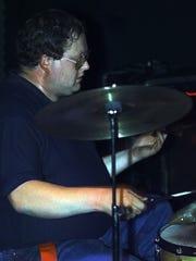 Ralph Bushey playing at Milestones in 1999.