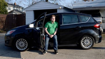 Debate over charging stations slows electric car growth in Michigan