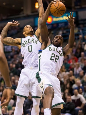 Bucks guard Gary Payton II (left) goes up for a rebound with teammate Khris Middleton Saturday night against the Utah Jazz. Payton got his fourth start of the season in the game.