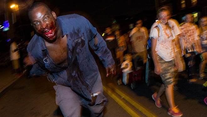 Dontai Jackson begs for brains during the 11th Annual Louisville Zombie Attack. August 29, 2015.