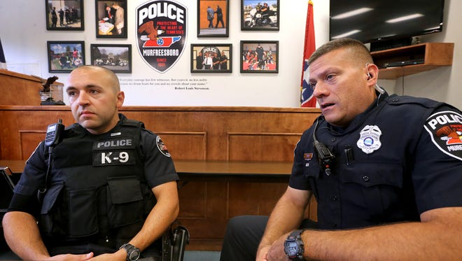 Murfreesboro Police officers and Marine veterans Mark Moghaddam, left, and Brant Voss talk about the new veteran pins on Wednesday, July 6, 2016.