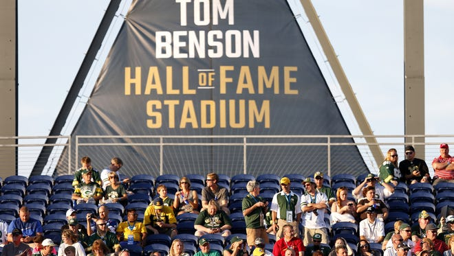 Fans wait for the official cancellation announcement of the NFL Hall of Fame Game at Tom Benson Hall of Fame Stadium in Canton, Ohio, on Aug. 7, 2016.