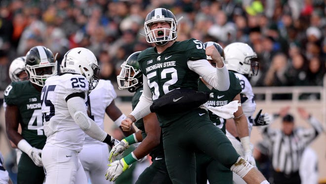 Long snapper Taybor Pepper (52) celebrates a tackle on a punt during the first half against Penn State Saturday, November 28, 2015, at Spartan Stadium in East Lansing.