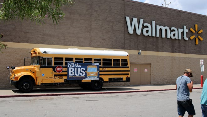 North Texas Area United Way's Fill the Bus campaign is outside the Lawrence Road Walmart Saturday, Aug. 5, 2017 to collect school supplies for Project Back to School Roundup.
