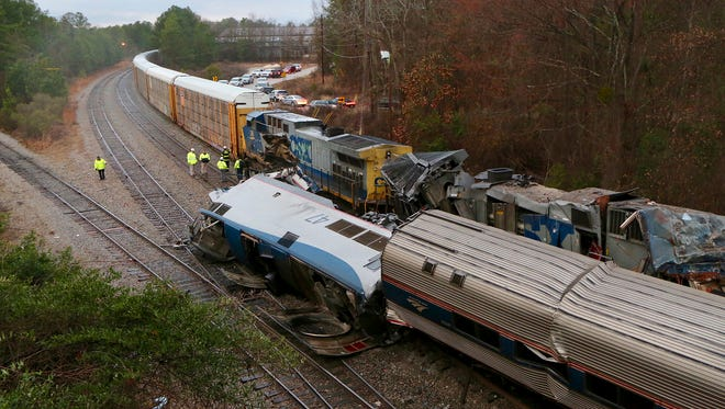 Authorities investigate the scene of a fatal Amtrak train crash in Cayce, S.C., Feb. 4, 2018. At least two were killed and dozens injured when an Amtrak passenger train collided with a CSX freight train.