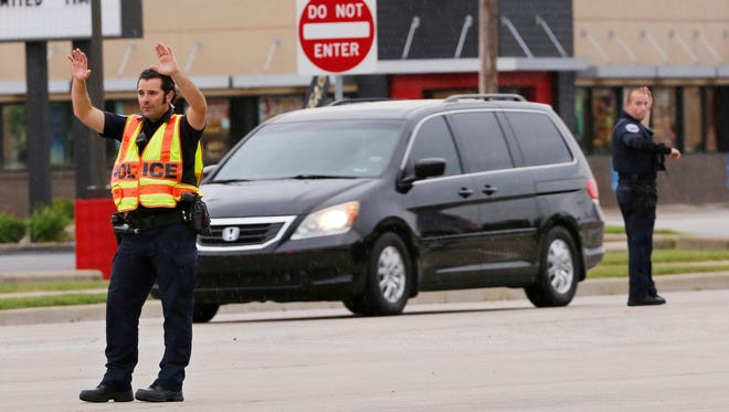 Lafayette Police Department officers direct traffic at the intersection of South Street and Park East Boulevard Thursday, July 5,2018, in Lafayette. Heavy storms in the afternoon left parts of Lafayette without power.