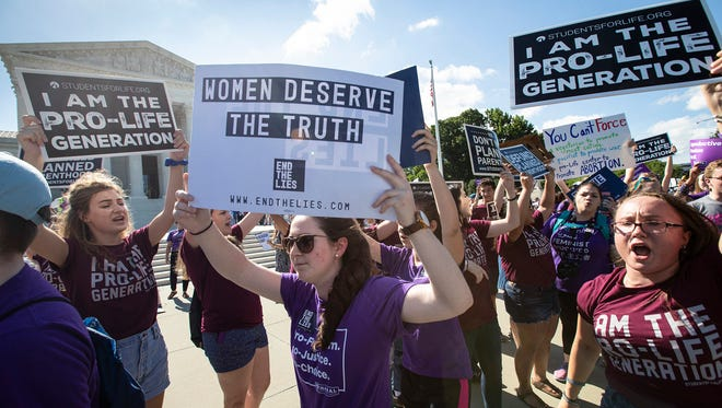 Demonstrators on both sides of the abortion issues protest in front of the Supreme Court on June 25, 2018. President Donald Trump is expected to name his Supreme Court nominee Monday, July 9, 2018.