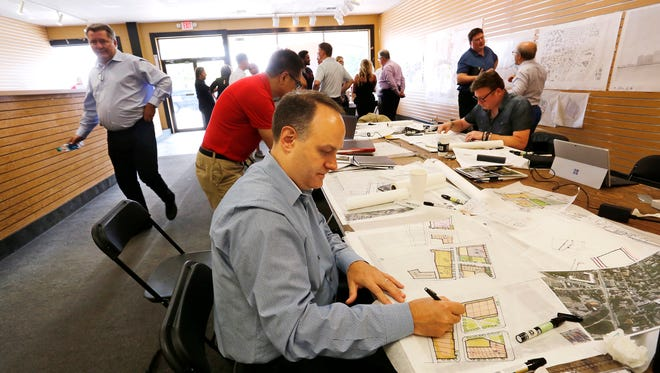Greg Gorski works on conceptual drawings for the redevelopment of Chauncey Hill Mall Tuesday, July 10, 2018, in West Lafayette. Trinitas Ventures, Lafayette, has architects on site through Friday as they seek public input on the redevelopment of Chauncey Village into The District at Chauncey Hill. Gorski is senior principal with Antunovich Associates, Chicago.