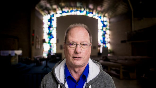 """Larry Day, 63, poses for a portrait at Corpus Christi Catholic Church in Springfield Township where he serves as a deacon. Over the past few years, he has developed a friendship with Josh Estes, a convicted killer in prison. They talk every day. """"He has risen above his environment. And you see that,"""" said Larry about Josh. """"He carries himself that way. He's his real focused on faith. He's really focused on helping other people be what they can be."""""""