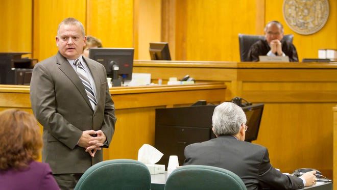Rep. Bill Kramer, R- Town of Waukesha, standing left, apologizes to the woman he assaulted in 2011 during a sentencing hearing on Tuesday.