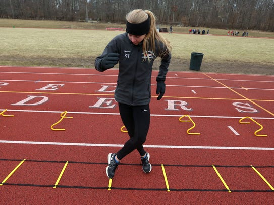 Katelyn Tuohy goes through a ladder drill during a