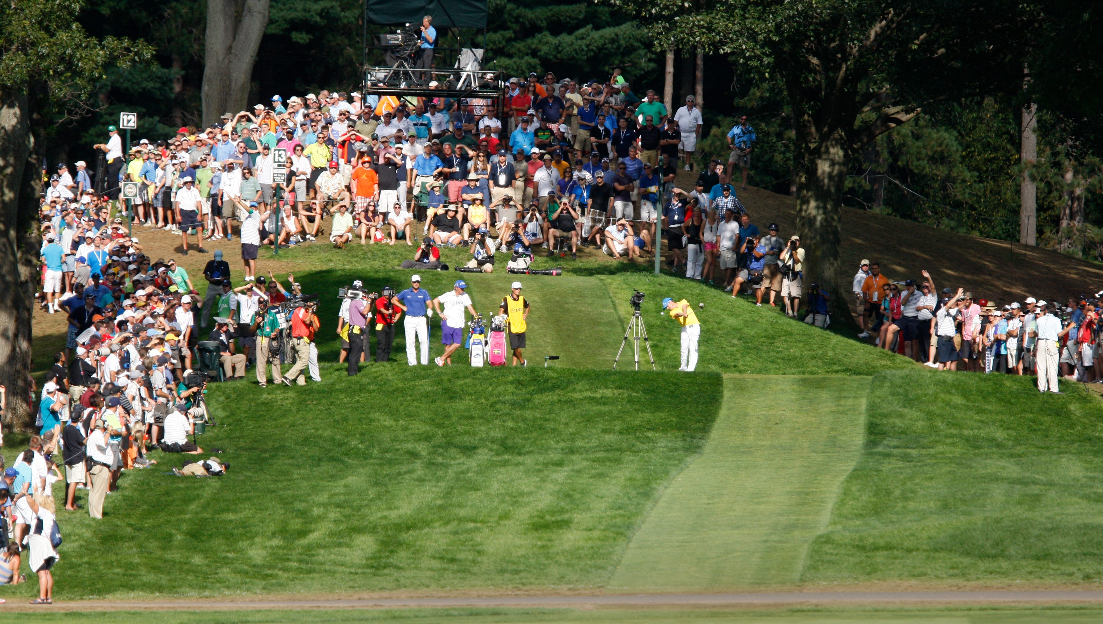Jonas Blixt hits from the elevated tee on the 13th during the final round of the 95th PGA Championship Sunday, Aug. 11, 2013 at Oak Hill Country Club in Pittsford.