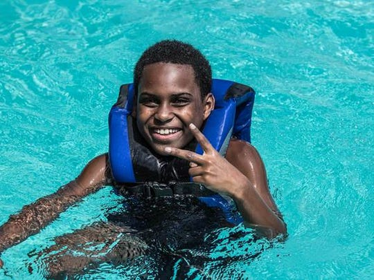 Michael Bernard finds peace in a pool at the six-day Camp HOPE experience held at an overnight camp nearby. Camp HOPE America has programs in eleven states. The Family Safety Center's camp in the only Camp HOPE program in Tennessee.