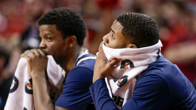 Michigan's Zavier Simpson, left, and Jaaron Simmons watch from the bench in the second half of the Wolverines' 72-52 loss to Nebraska in Lincoln, Neb., Thursday, Jan. 18, 2018.