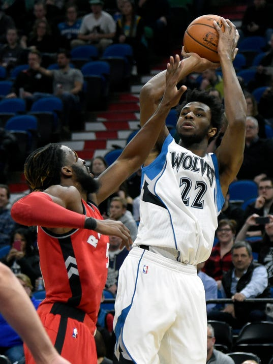 Minnesota Timberwolves forward Andrew Wiggins (22) shoots against Toronto Raptors forward DeMarre Carroll during the first quarter of an NBA basketball game on Wednesday, Feb. 8, 2017, in Minneapolis. (AP Photo/Hannah Foslien)