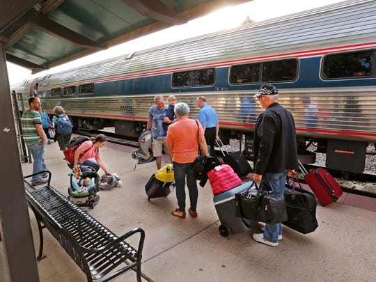 Passengers prepare to board the Cardinal at the Amtrak platform Thursday, June 29, 2017, at Riehle Plaza. On this morning, the Cardinal, which is scheduled to arrive at 7:36 a.m., arrived at 8:12 a.m.