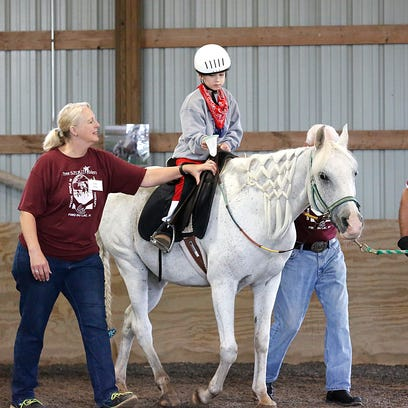 Free Spirt Riders held their 25th annual ride-a-thon Saturday morning, at their location at W3956 Highway 23.  Free Spirit Riders is a non-profit organization committed to enriching the lives of children and adults with disabilities from Fond du Lac and the surrounding area through safe, therapeutic interaction with horses. Saturday August 29, 2015.