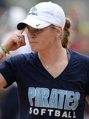 Bay Port softball coach Jenna Woepse reminds her baserunner